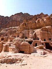 6757840-tombs-in-petra--nabataeans-capital-city-al-khazneh--jordan-made-by-digging-a-holes-in-the-rocks-roma