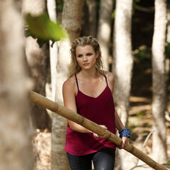 Andrea carrying bamboo.