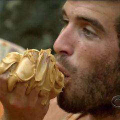 Eddie eating peanut butter.