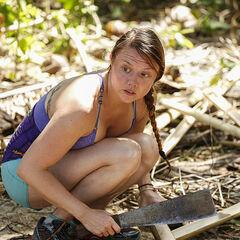 Jessica chopping bamboo.