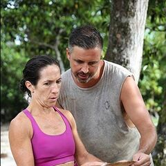 Adam and Kate read the clue to the Hidden Immunity Idol.