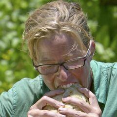 Kass eating a sandwich she bought.