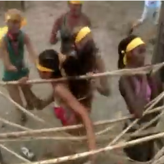 The ladies breaking sticks in <i>Nicaragua</i>.