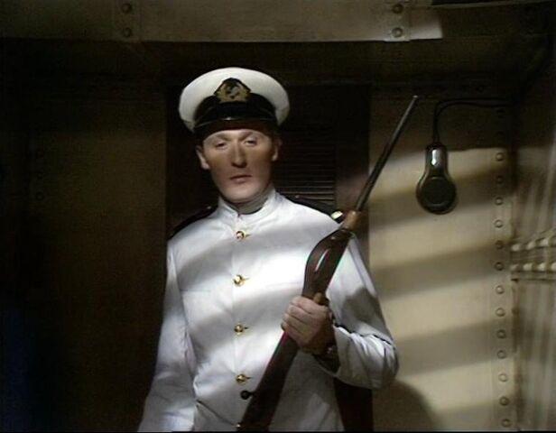 File:John Andrews with rifle.jpg