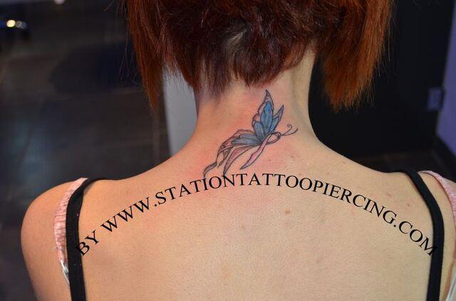 File:Buterfly tattoo,colour,neck,back,female,.jpg