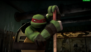 Raph with Donnie's staff