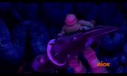 Scorpinoid Holding Raphael