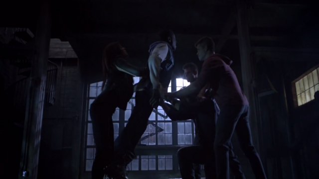 File:Teen Wolf Season 3 Episode 7 Currents Kali drops Boyd on Derek's claws.png