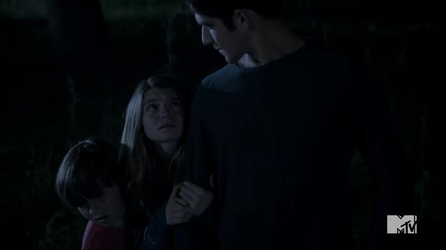 File:Teen Wolf Season 3 Episode 3 Fireflies Tyler Posey Scott McCall saves kids.png