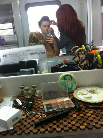 File:Teen Wolf Behind the Scenes Holland Roden Make up with puppy.png