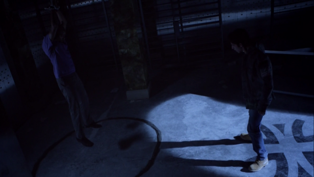File:Teen Wolf Season 3 Episode 7 Currents Seth Gilliam Tyler Posey Scott faces mountain ash around deaton.png