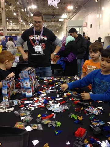 File:TK representative watching the children build at ChiTAG Fair 2013.jpg