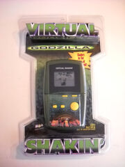 MGA GODZILLA VIRTUAL SHAKIN' Hand-Held LCD game MOSC NEW 1998 movie version