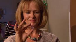 Vera, holding Jerome's gem