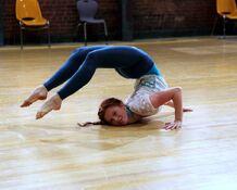 Giselle hugging a floor