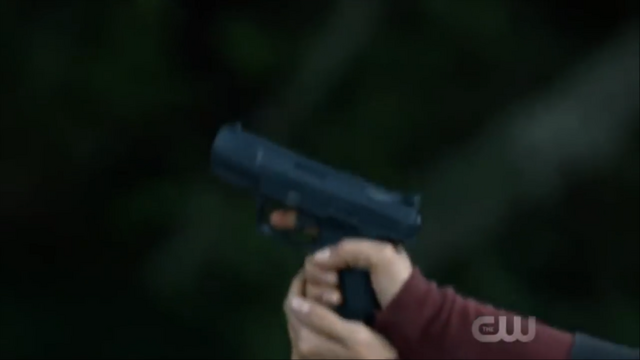File:Handgun in A lie Guarded.png