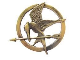 File:Mockingjay pin ( Katniss Everdeen's token) .jpg