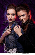 Stock-photo-female-twins-in-colored-light-studio-shooting-low-key-65779786-1-
