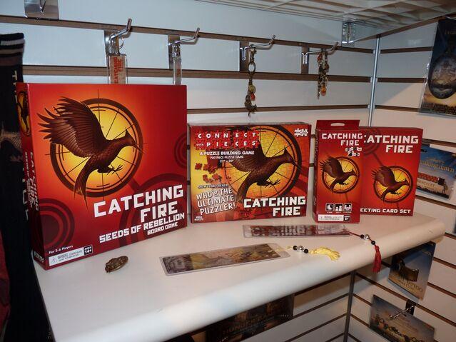 File:Catching fire mixed merchandise.jpg