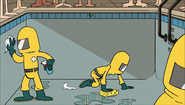 S1E08A People in hazmat suits scrubbing the pool