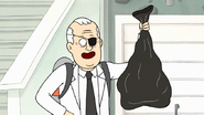 S7E28.210 Dr. Langer Holding a Trash Bag