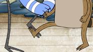 S3E34.119 Rigby Kicking Mordecai's Shin