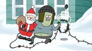 S6E10.023 Muscle Man Holding a Santa Claus Decoration