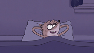 S7E24.038 Rigby Laying in His New Bed