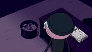 S7E19.121 Benson Looking in Gene's Trash Bin