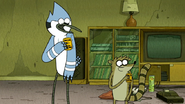 S6E19.191 Mordecai and Rigby Putting the Badges On