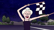 S7E21.178 Flag Girl Pointing at Finish Line