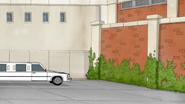 S4E21.099 Limo Stopping at a Brick Wall