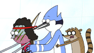 S7E05.342 Mordecai and Rigby Riding Behind Benson