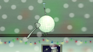 S6E10.163 The Ladle Hitting the Mistletoe Disco Ball
