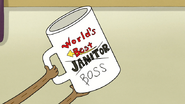 S4E33.063 World's Best Janitor Mug with Boss on It