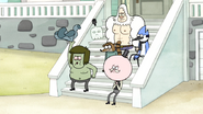 S6E09.005 Muscle Man Takes His Shirt Off