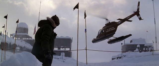 File:American Helicopter departing Outpost 32 - The Thing (1982).png
