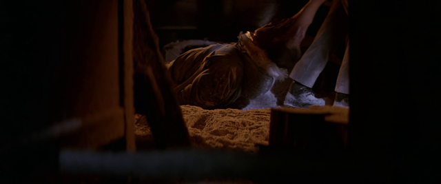 File:An assimilated Garry is dragged away -The Thing (1982).png