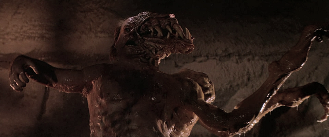 File:The Blair-Thing rises from the ground - The Thing (1982).png