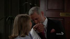 Graham kisses Dina's hand