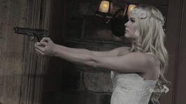 Courtney holding gun