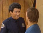 John Larroquette Police Officer