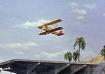 Thunderbird 6 flying off the runway of Tracy Island