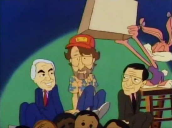 File:Spielberg on top of a pile of staff workers.png