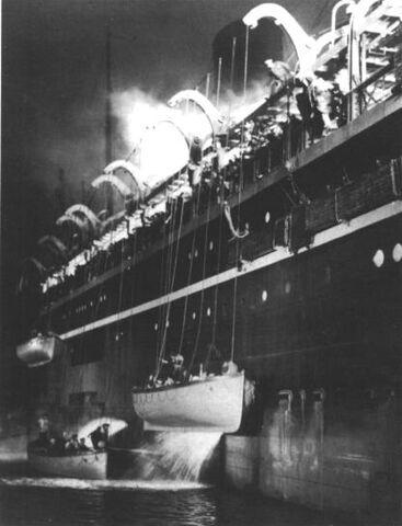 File:Atlantic Titanic Movie LifeBoats being Lowered away.jpg