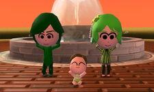 Family exercising at fountain