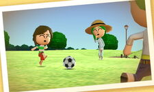 A family playing soccer