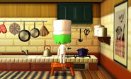 A Mii cooking with frying pan