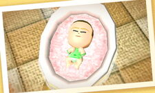 A baby in it's bassinet