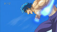 Toriko doing Twin Kugi Punch with Fork Shields on his fists